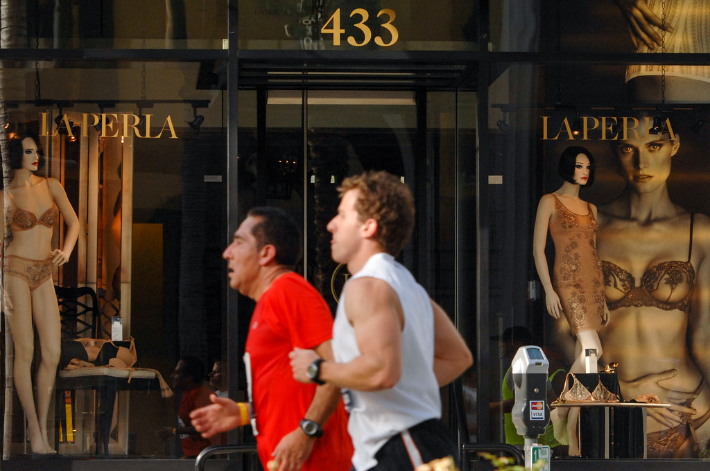 . Runners pass storefronts on Rodeo Drive in Beverly Hills during the Los Angeles Marathon, Sunday, March 9, 2014. (Photo by Michael Owen Baker/L.A. Daily News)