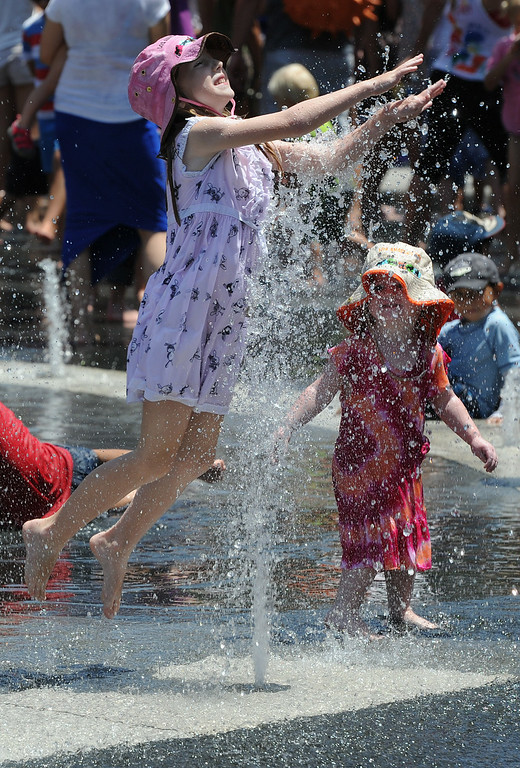 . Children leap, play and dance in the fountain plaza at Grand Park during the 5th Annual National Dance Day. The celebration was held at Grand Park and The Music Center. More than 2,000 people participated in the free all-day dance extravaganza.  Los Angeles CA. 7/25/2014(Photo by John McCoy Daily News)