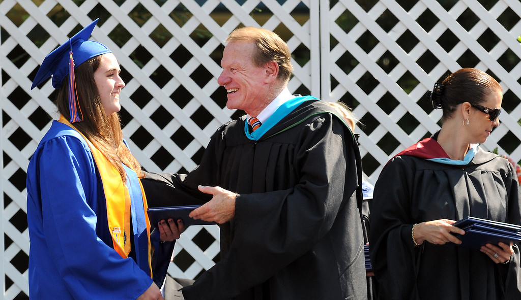 . President James Adams, hands out a diploma.  Chaminade College Preparatory High School, celebrating its 60th anniversary, graduated 337 students at the West Hills campus on Saturday, June 01, 2013.  (Dean Musgrove/Los Angeles Daily News)