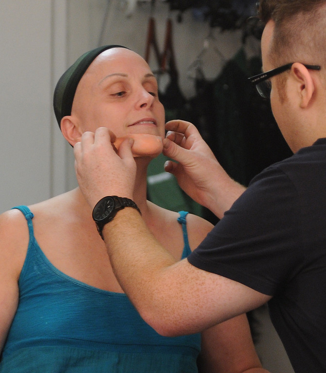 . The chin is the first part of the makeup. Jacquelyn Piro Donovan is transformed into the Wicked Witch by makeup artist Michael King. The Wizard of Oz is being staged at the Pantages Theatre in Hollywood, CA. 9/25/2013. photo by (John McCoy/Los Angeles Daily News)