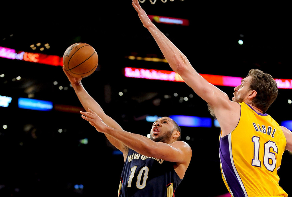 . New Orleans Pelicans guard Eric Gordon (10) gets by Los Angeles Lakers center Pau Gasol (16) on a fast break for a basket in the first half of an NBA basketball game, Tuesday, March 4, 2014, in Los Angeles.(AP Photo/Gus Ruelas)
