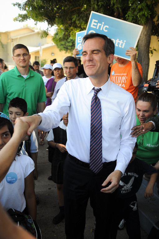 . Mayoral candidate Eric Garcetti greets people in front of Dolores Mission Church in East Los Angeles during his Whistle Stop Tour of LA, Monday, May 20, 2013. Garcetti used the Expo, Gold and Red metro lines to greet voters in Los Angeles. (Michael Owen Baker/Staff Photographer)