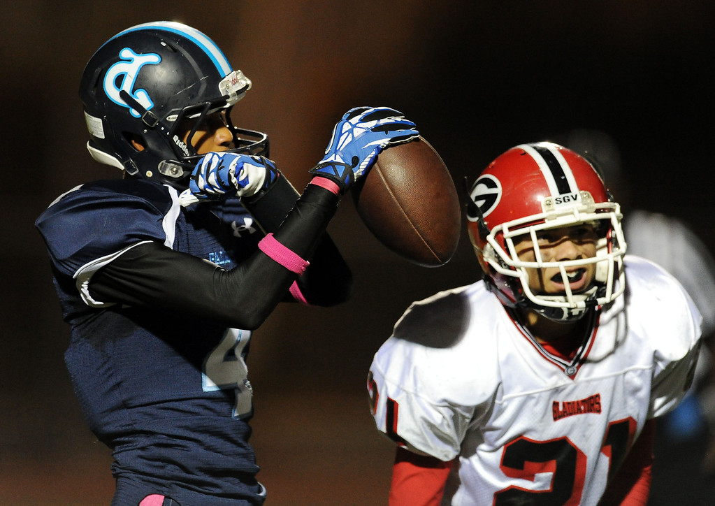 . Duarte\'s Victor Nureldeen (4) reacts after catching a pass for a touchdown over Gladstone\'s Zachary Herrera (21) in the first half of a prep football game at Duarte High School in Duarte, Calif., Thursday, Oct. 10, 2013.    (Keith Birmingham Pasadena Star-News)