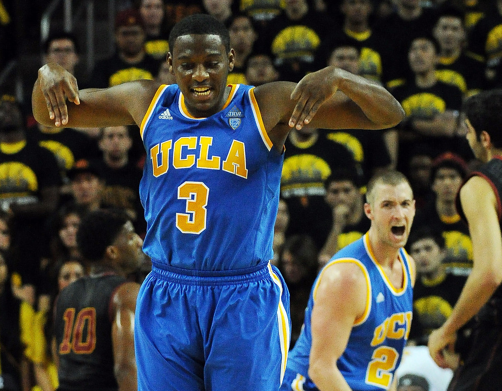 . UCLA\'s Jordan Adams (3) reacts after hitting a three pointer along with teammate Travis Wear (24) in the second half of a PAC-12 NCAA basketball game against Southern California at Galen Center in Los Angeles, Calif., on Saturday, Feb. 8, 2014. UCLA won 83-73. (Keith Birmingham Pasadena Star-News)