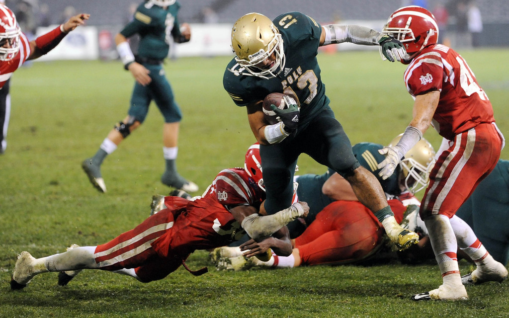 . Anaheim, Calif., --12-01-12 - Long Beach Poly\'s Manusamoa Luuga drives in for a touchdown in the fourth quarter. Long Beach defeated Mater Dei 35-17  for the CIF-SS Pac-5 Division championship, at Anaheim Stadium.   Stephen Carr/  LANG