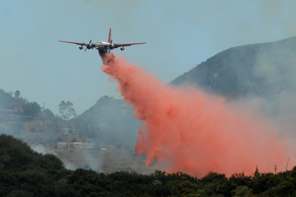 . An air tanker drops fire retardant near Deer Creek Road in Ventura County, Friday, May 3, 2013. (Michael Owen Baker/Los Angeles Daily News)