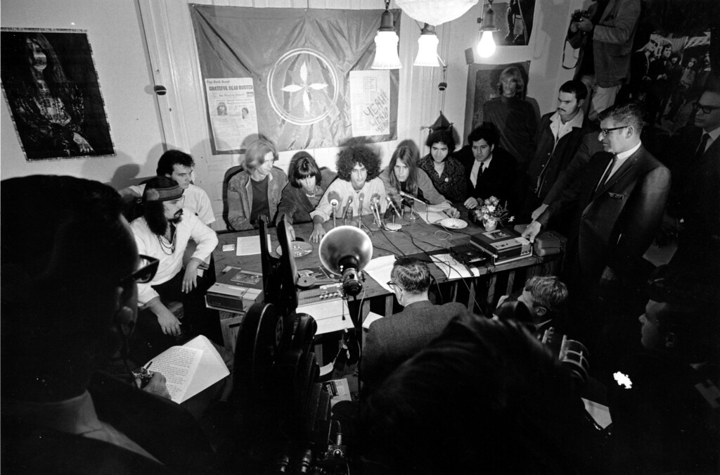 . Members of the folk rock group Grateful Dead talk with reporters in their home in San Francisco, Calif., on Oct. 5, 1967.  The Grateful Dead protested being busted by the police for marijuana possession.  From left to right, the group members are, Ron McKernan, Bill Kreutzmann, Phil Lesh, managers Rock Scully and Dan Rifkin, Bob Weir, Jerry Garcia, attorney Michael Stepanion and equipment manager Robert Mathews.  (AP Photo)