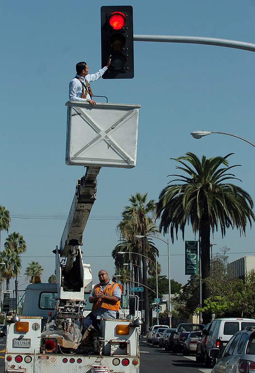 . Long Beach Vice Mayor Robert Garcia places his hand on the new traffic signal at Pacific Avenue and Ninth Street during a brief ceremony in Long Beach, CA. Monday September 16, 2013.  (Photo by Thomas R. Cordova/ Daily Breeze)