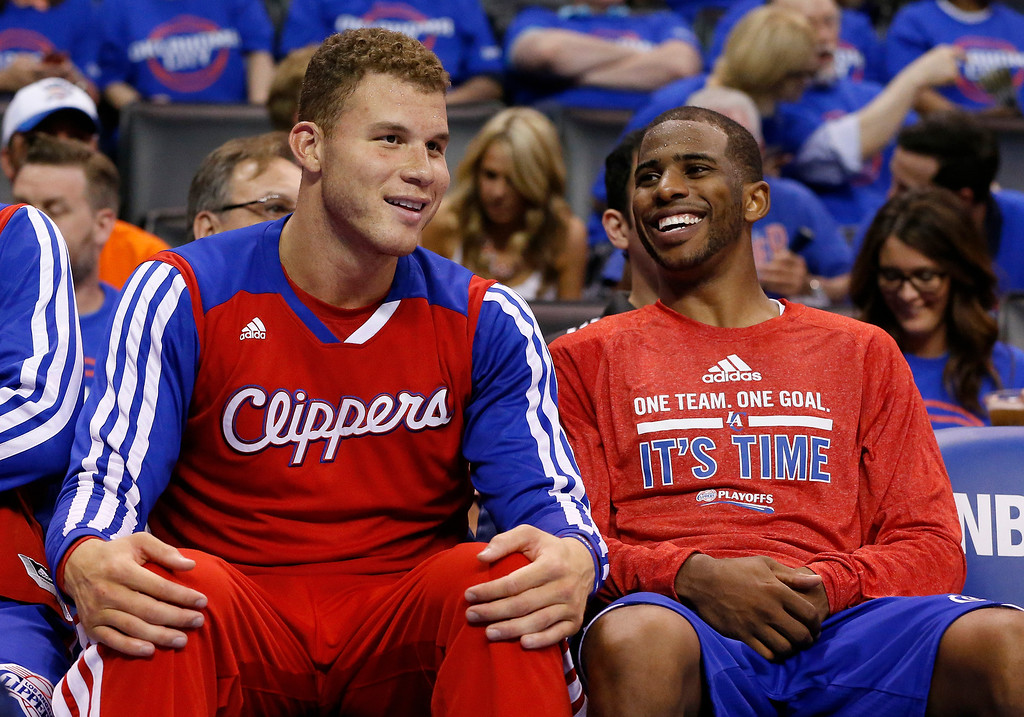 . Los Angeles Clippers guard Chris Paul, right, laughs with teammate Blake Griffin, left, as they sit on the bench in the fourth quarter of Game 1 of the Western Conference semifinal NBA basketball playoff series in Oklahoma City, Monday, May 5, 2014. Los Angeles won 122-105. (AP Photo/Sue Ogrocki)