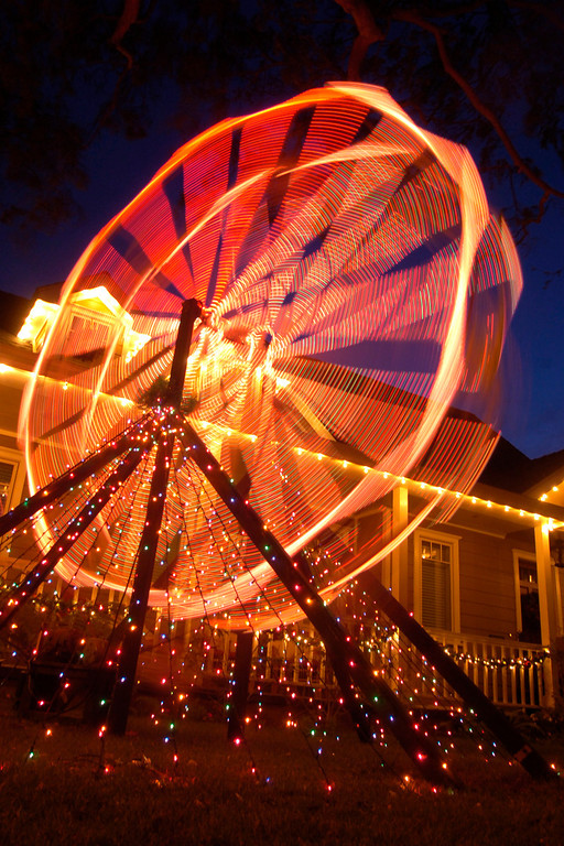 . TORRANCE - 12/12/06 - DAILY BREEZE PHOTO: SCOTT VARLEY - Christmas lights and big displays have long been a tradition in the Sleepy Hollow neighborhood of Torrance. This house on Reese Road has a small Ferris wheel in their front yard.