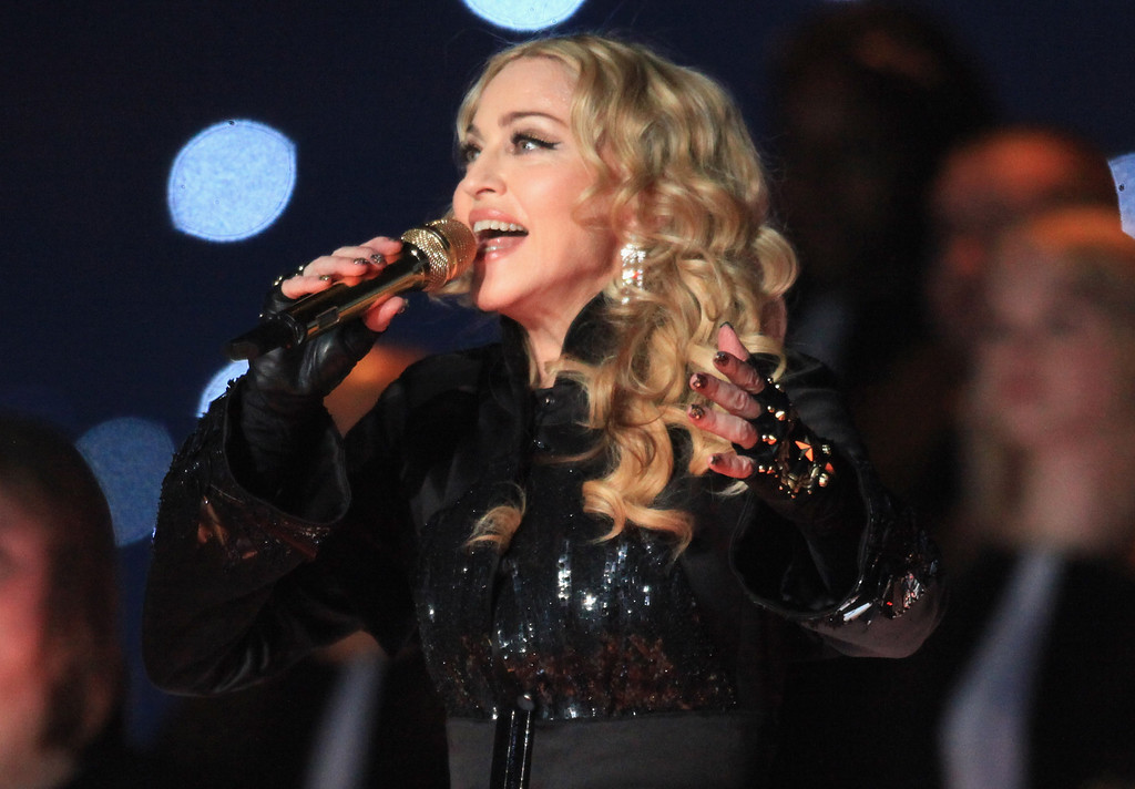 . INDIANAPOLIS, IN - FEBRUARY 05:  Madonna performs during the Bridgestone Super Bowl XLVI Halftime Show at Lucas Oil Stadium on February 5, 2012 in Indianapolis, Indiana.  (Photo by Christopher Polk/Getty Images)