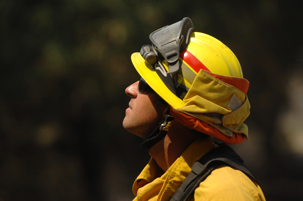 . Riverside City firefighter Dan Wible keeps an eye on the Springs Fire hotspots on Potrero Road in Newbury Park, Saturday, May 4, 2013. (Michael Owen Baker/Staff Photographer)