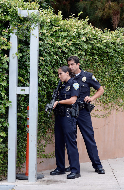 . SANTA MONICA, CA - JUNE 07:  Los Angeles Police Department Officers deploy around the grounds of Santa Monica College near the library after multiple shootings  were reported on the campus June 7, 2013 in Santa Monica, California.  According to reports, at least three people have been injured, and a suspect was taken into custody. (Photo by Kevork Djansezian/Getty Images)