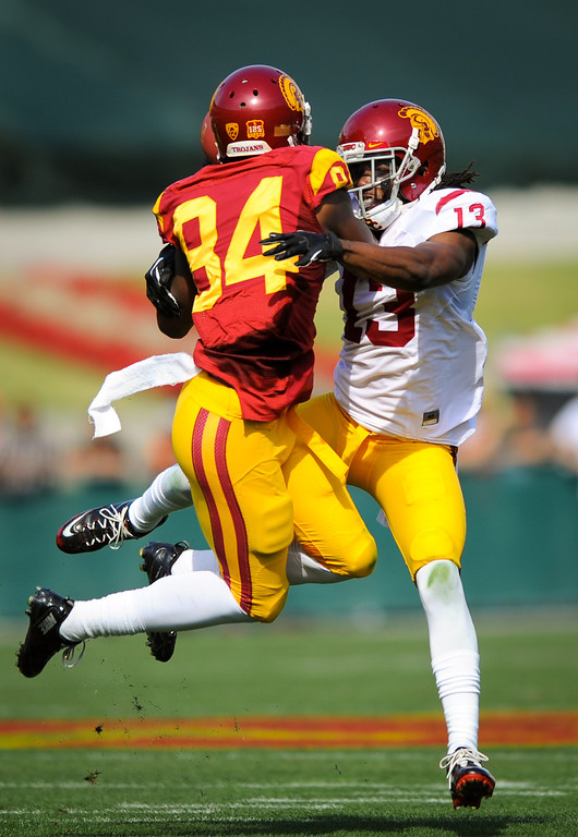 . USC WR Darreus Rogers tries to haul in a long bomb as DB Kevon Seymour defends at the spring game. (Photo by Michael Owen Baker/L.A. Daily News)
