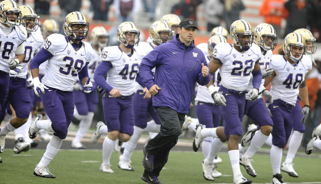. Washington\'s head coach Steve Sarkisian, center, runs onto the field with his team before an NCAA college football game against Oregon State in Corvallis, Ore., Saturday, Nov 19, 2011. (AP Photo/Greg Wahl-Stephens)