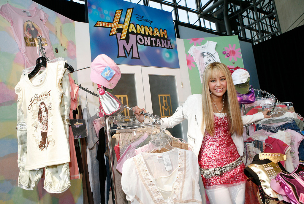 """. In this photo released by Disney, Miley Cyrus, the star of Disney Channel\'s top-rated series \""""Hannah Montana,\"""" unveils the new Hannah Montana fall fashion collection, Tuesday, June 19, 2007, in New York, during the International Licensing Expo.   (AP Photo/Disney, Diane Bondareff)"""