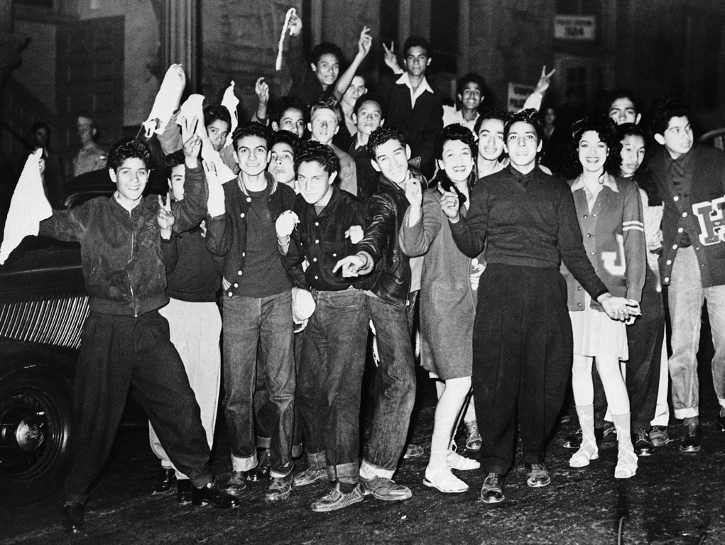 . Evidently trying to show that hostilities in Los Angeles between serviceman and zoot suiters are over, these juveniles, several girls among them, cruised thru downtown streets in six automobiles June 11, 1943, flying American flags and white flags of truant police took them into custody and soon released them, after telling them they would be protected as American citizens but would not be allowed to congregate in gangs. (AP Photo)