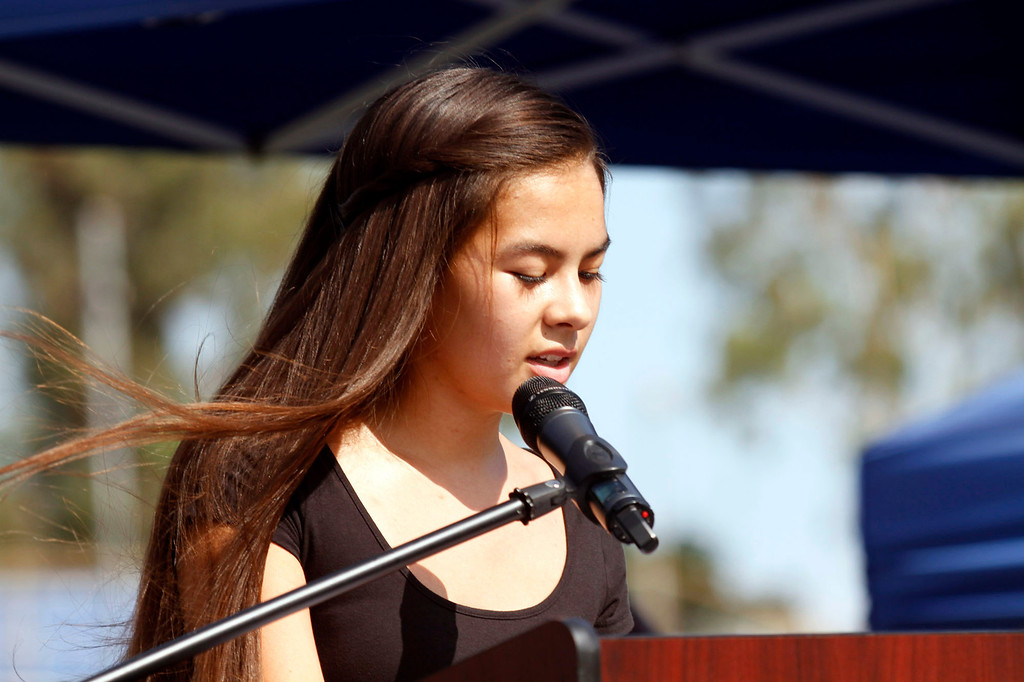 """. Cheyenne Heath-Warr, of the Crossroads Community Church, gives a reading, during the Vietnam Veterans Memorial \""""The Wall That Heals\"""" Closing Ceremony event, at La Habra High School, in La Habra, Sunday, July 14, 2013. (SGVN/Correspondent Photo by James Carbone)"""