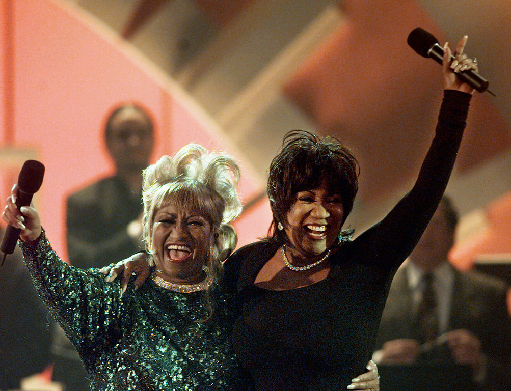 . Legendary performers Celia Cruz, left, and Patti LaBelle embrace and wave to the crowd at the 1998 Alma Awards Sunday, April 19, 1998 in Pasadena, Calif. The Alma Awards recognizes Latino contributions to television and movies. (AP Photo/Susan Sterner)