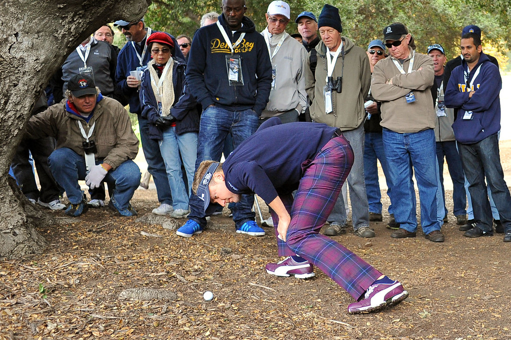 . Ian Poulter checks his lie after hitting an errant tee shot on the first hole during the second round of the Northwestern Mutual World Challenge golf tournament at Sherwood Country Club, Friday, December 6, 2013, in Thousand Oaks, Calif. (Andy Holzman/Los Angeles Daily News)