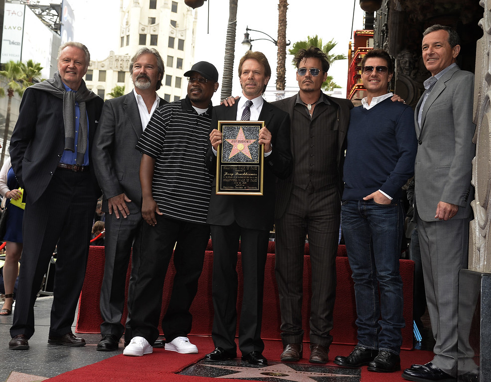 . US producer Jerry Bruckheimer (C) is honored with a star on the Hollywood Walk of Fame in Hollywood, California, USA, 24 June 2013. Joining him for photos are from L to R: actor Jon Voight, director Gore Verbinski, actor Martin Lawrence, Bruckheimer, actor Johnny Depp, actor Tom Cruise and Walt Disney Company Chairman and CEO Bob Iger. Bruckheimer received the 2,501st star on the Hollywood Walk of Fame.  EPA/MICHAEL NELSON