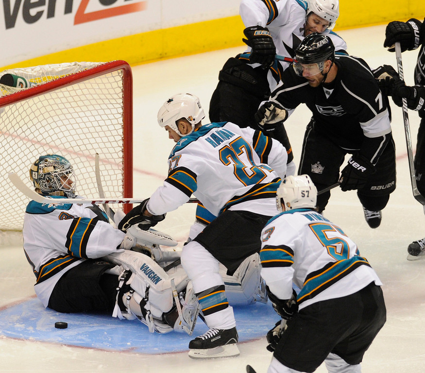 . The Kings#7 Rob Scuderi could not get the puck past Sharks defenders in the 3rd period. The Kings defeated the San Jose Sharks 2-0 in the first game of the Second Round of the Western Conference Playoffs. Los Angeles CA 5/14/2013(John McCoy/LA Daily News)