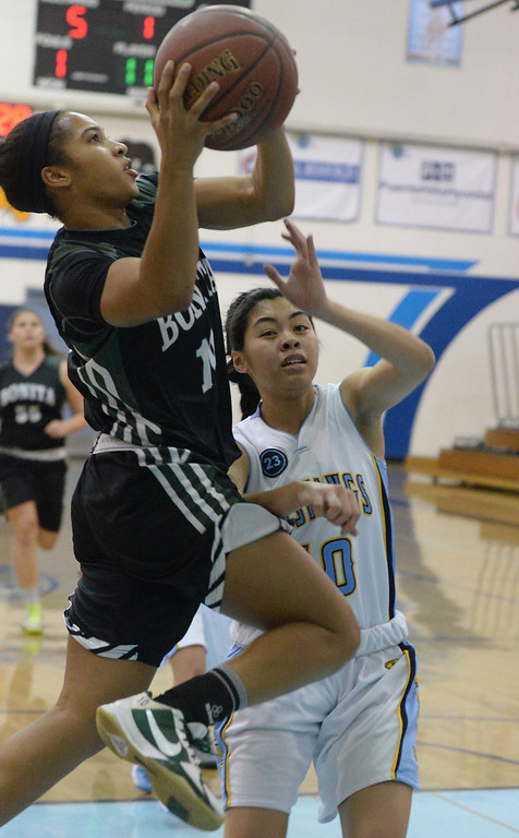 . Bonita\'s Nikki Wheatley (C) (10) drives to the basket past Walnut\'s Katya Echavez (10) in the first half of a prep basketball game at Walnut High School in Walnut, Calif., on Wednesday, Jan. 15, 2014. Bonita won 60-50. (Keith Birmingham Pasadena Star-News)