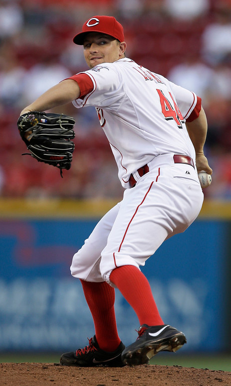 . Cincinnati Reds starting pitcher Mike Leake throws against the Los Angeles Dodgers in the first inning of a baseball game, Friday, Sept. 6, 2013, in Cincinnati. (AP Photo/Al Behrman)