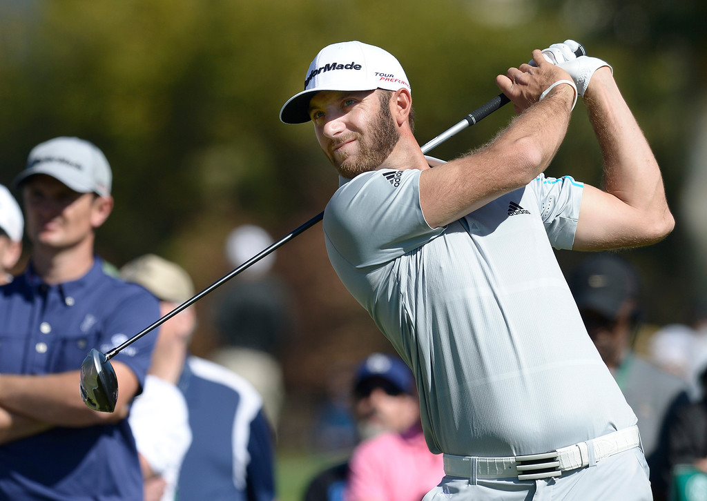 . Dustin Johnson tees off from the second round of the Northern Trust Open. Pacific Palisades, CA. February 13, 2014 (Photo by John McCoy / Los Angeles Daily News)