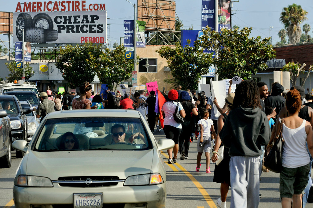 . Intersection of Martin Luther King Jr. Bouelvard and Crenshaw Bouelvard in South L.A.  Occupy LA organizers are holding a march to protest a jury\'s decision to clear George Zimmerman of all charges in the shooting death of the 17-year-old unarmed Florida teen Trayvon Martin.  (Mike Mullen / Los Angeles News Group)