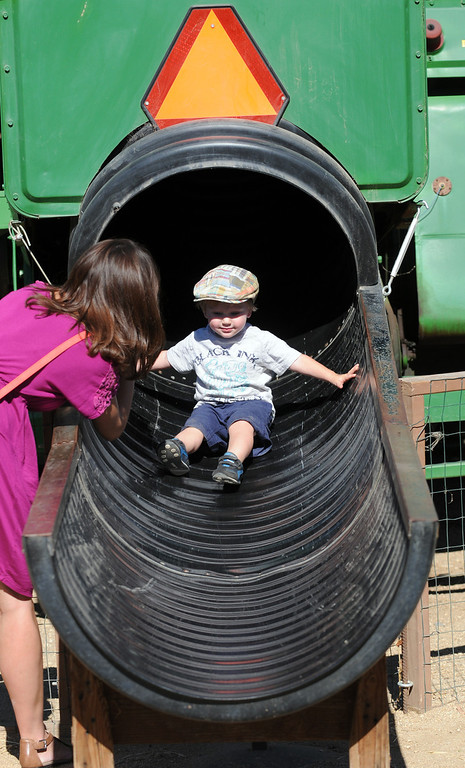 . Jude Cowden, 22 months, from Ventura slides down the John Deere slide.  Underwood Family Farms in Moorpark, CA hosted its Friends of the Farm weekend, launching its Fall Harvest Festival, which runs through Halloween.  The Saturday, September 28, 2013, event benefits the Ventura County Sheriff\'s & Fire Departments.  (Photo by Dean Musgrove/Los Angeles Daily News)