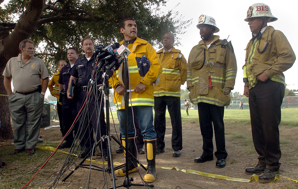 . Los Angeles mayor Antonio Villaraigosa holds a news conference with other city officials at the site of the collision between a Metrolink commuter train and a freight train in Chatsworth. (September 13, 2008) (L.A. Daily News file photo)