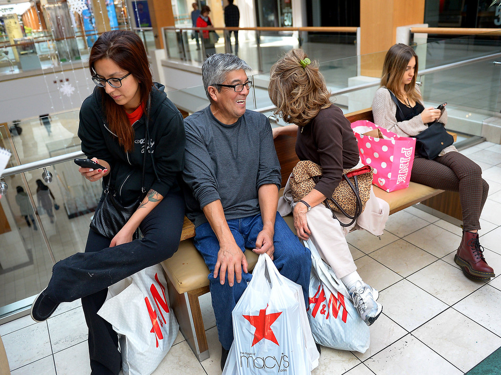 . Madi Farfan, left, and her father Victor Farfan take a break from shopping at the Westfield Topanga, Thursday, December 26, 2013. (Photo by Michael Owen Baker/L.A. Daily News)