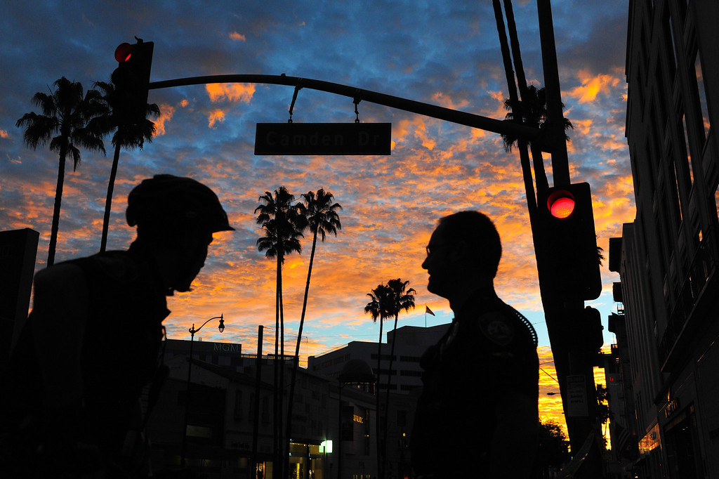 . Beverly Hills police officers stand along Wilshire Boulevard at dawn before the start of the Los Angeles Marathon, Sunday, March 9, 2014. (Photo by Michael Owen Baker/L.A. Daily News)