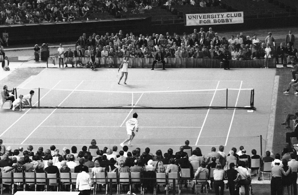 . Billie Jean King displays her winning form as she goes low to return a volley by Bobby Riggs in their winner take all $100,000 match in the Astrodome in Houston, Texas on Thursday, Sept. 21, 1973. Ms. King defeated Riggs in the well publicized match, 6-4, 6-3, 6-3. (AP Photo)