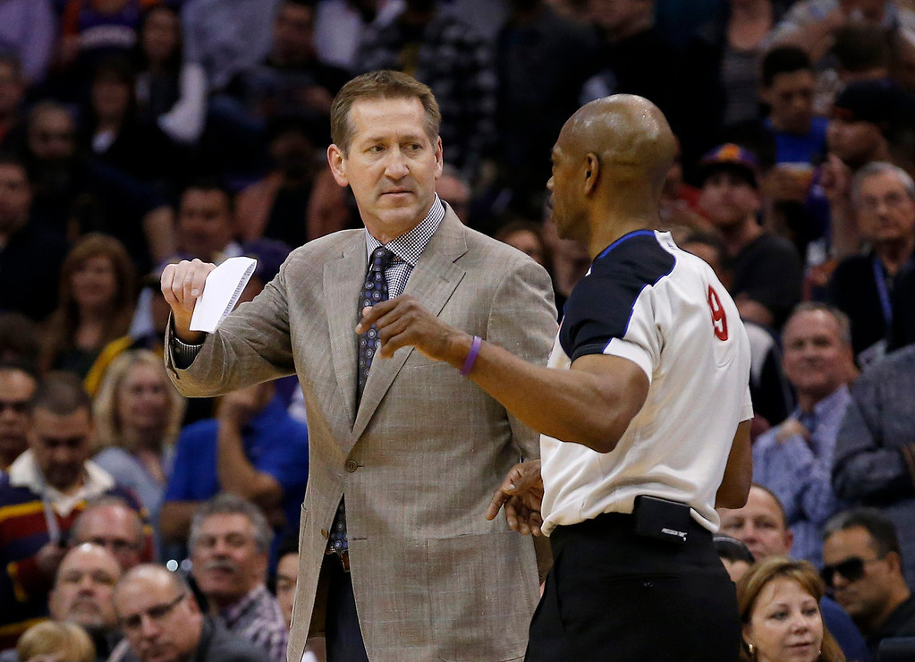 . Phoenix Suns coach  Jeff Hornacek, left, gets an explanation from referee Tom Washington after a scuffle resulted in the ejections of Suns\' Alex Len and Los Angeles Lakers\' Nick Young during the first half of an NBA basketball game Wednesday, Jan. 15, 2014, in Phoenix. (AP Photo/Ross D. Franklin)