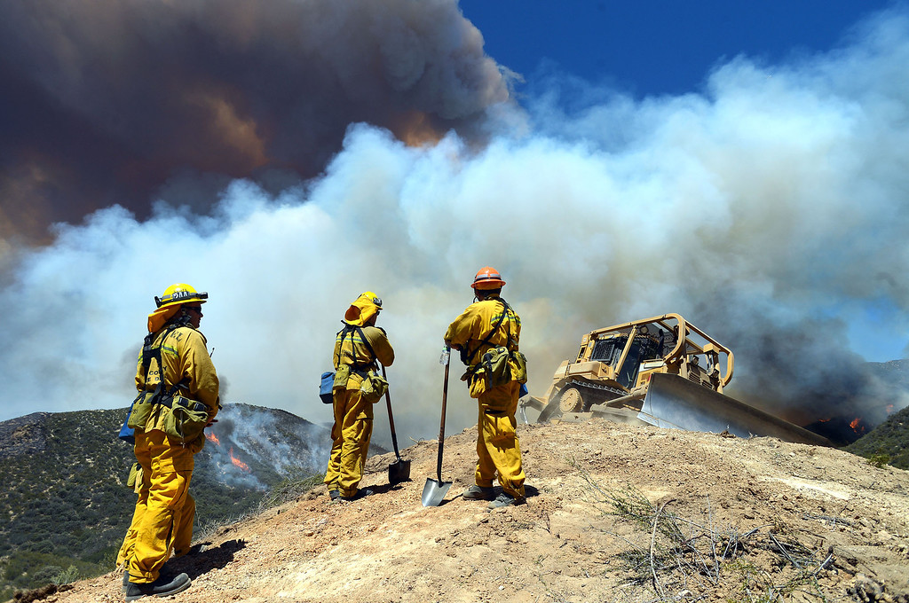 . Firefighters and a dozer work the Powerhouse Fire near Green Valley, CA Friday, May 31, 2013.(Andy Holzman/Staff Photographer)