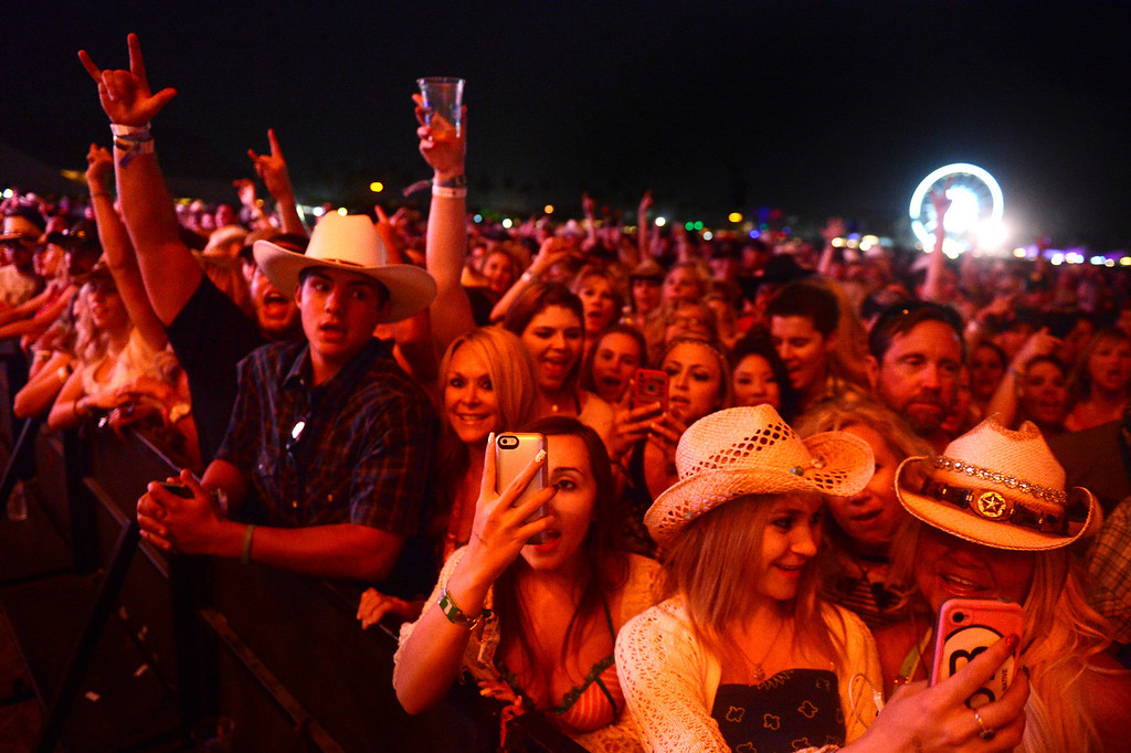 . Festival-goers watch Brantley Gilbert perform during the first day of Stagecoach Country Music Festival in Indio, Friday, April 25, 2014. (Photo by Sarah Reingewirtz/Pasadena Star-News)