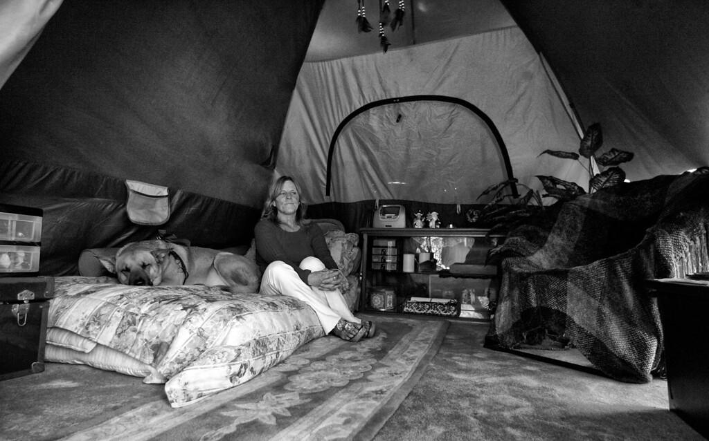 . Her tent has enough space for a bed, some of her belongings and a chair.