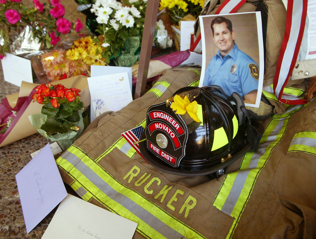 . A memorial for fallen firefighter Steven Rucker on display at his firehouse in Novato, Calif., is shown Thursady Oct. 30, 2003. Rucker was killed Wednesday, battling the Cedar Fire in Southern California. (AP Photo/George Nikitin)