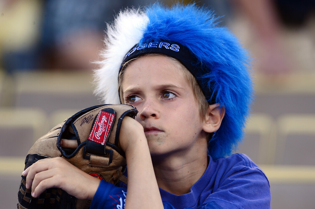 . Austin Krischer, 7, waits for Saturday night\'s Dodger game to begin against the Rockies at Dodger Stadium, on September 28, 2013. (Photo by Sarah Reingewirtz/Pasadena Star-News)