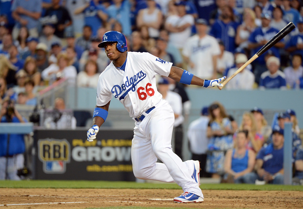 . Dodgers\' Yasiel Puig hits the ball during game 3 of the NLDS at Dodger Stadium Sunday, October 6, 2013. (Photo by David Crane/Los Angeles Daily News)