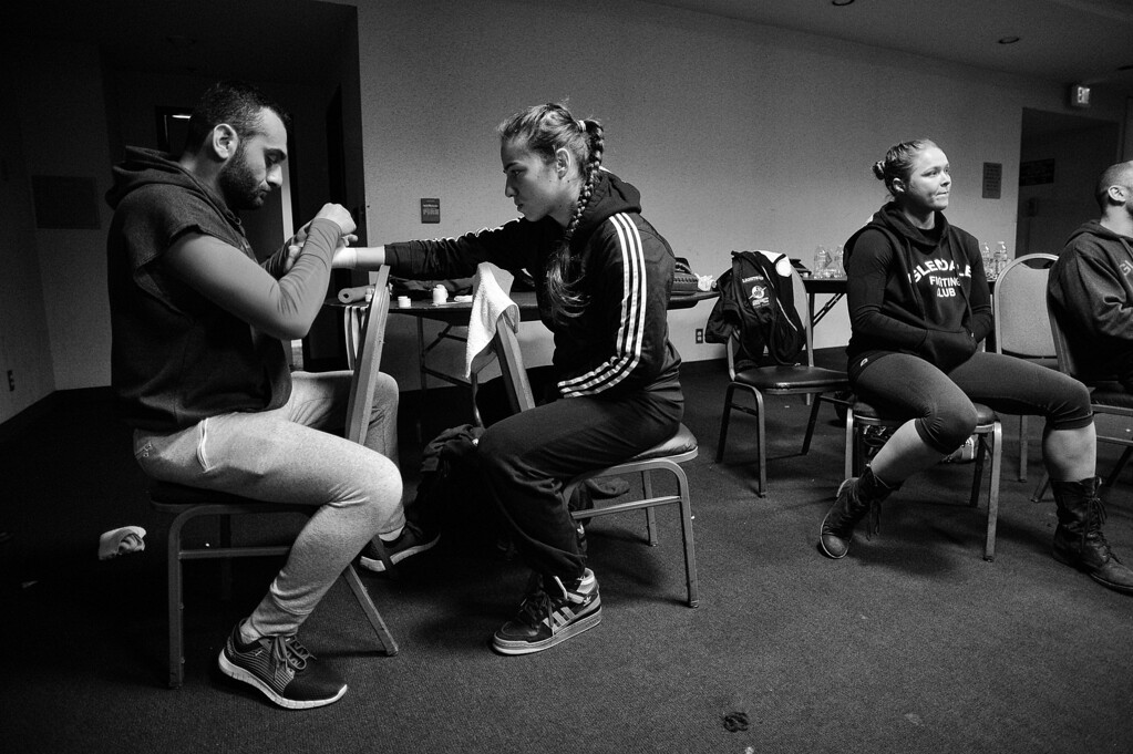. Coach Edmond Tarverdyan wraps Marina Shafir\'s hands as friend and teammate Ronda Rousey sits near by before Shafir\'s professional debut at  Chaos at the Casino 4 at Hollywood Park Casino in Inglewood, CA. (Photo by Hans Gutknecht/Los Angeles Daily News)