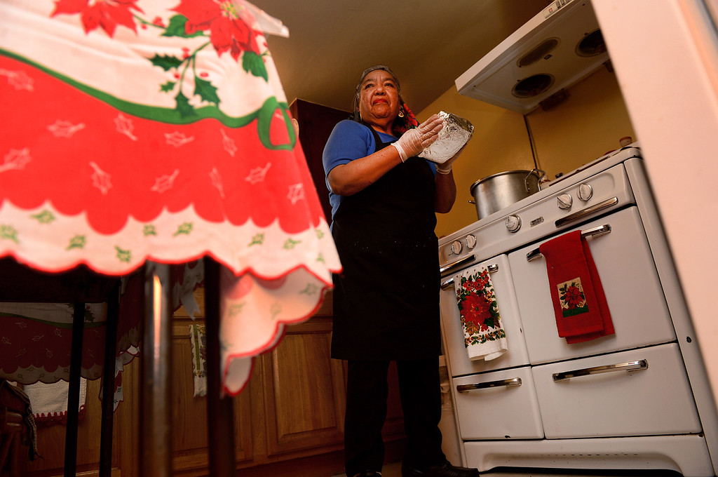 . Santos Garza, 68, makes Christmas tamales for friends and family Saturday, December 21, 2013 in her Rosemead home that she shares with her 83-year-old husband Emede. Garza expects to make 18 dozen chicken, cheese and pork tamales this year. Tamales are a Christmas Eve tradition in Mexico. (Photo by Sarah Reingewirtz/Pasadena Star-News)