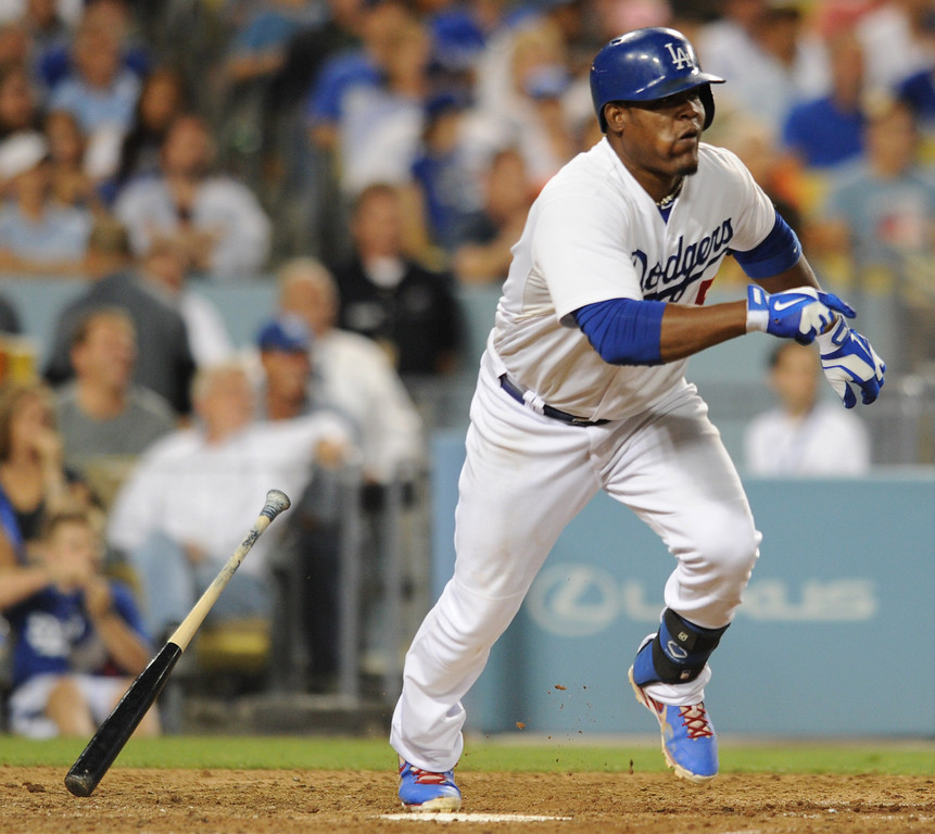 . Juan Uribe heads to first while driving in Hanley Ramirez in the 6th inning. The Cubs were in town to play the Dodgers. Los Angeles, CA. 8/24/2013(John McCoy/LA Daily News)