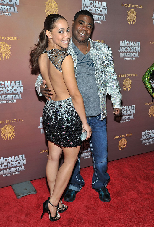 . Megan Wollover (L) and actor/comedian Tracy Morgan attend Michael Jackson THE IMMORTAL World Tour show by Cirque du Soleil at Madison Square Garden on April 3, 2012 in New York City.  (Photo by Mike Coppola/Getty Images)