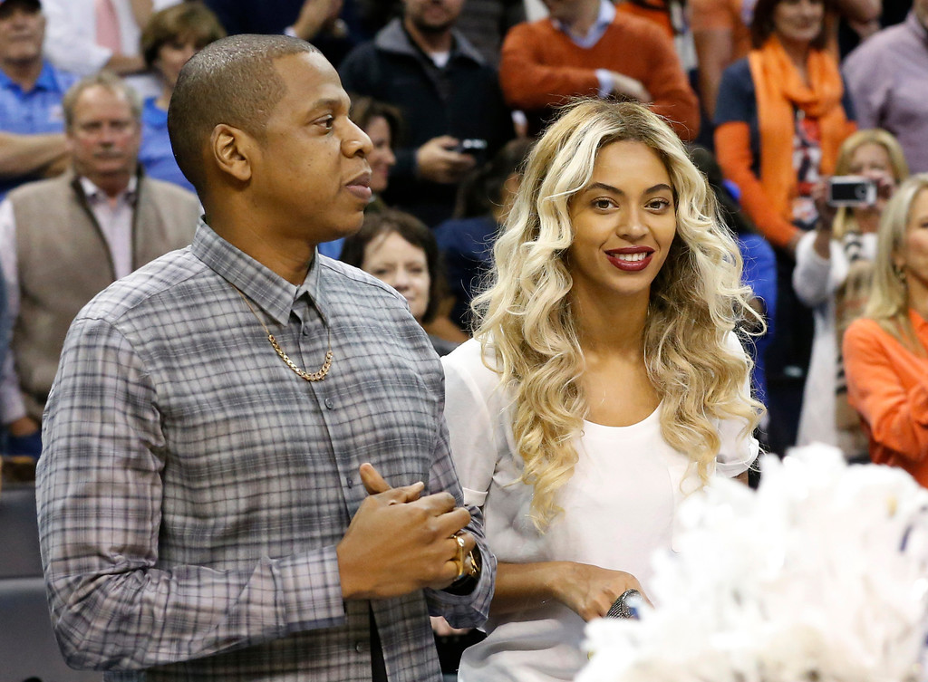 . Jay-Z and Beyonce are pictured before the start of an NBA basketball game between the Oklahoma City Thunder and the Los Angeles Clippers  in Oklahoma City, Thursday, Nov. 21, 2013. (AP Photo/Sue Ogrocki)