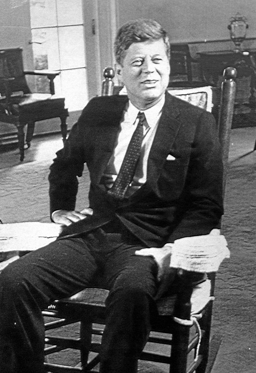 . President John F. Kennedy sits in his rocking chair in the White House in 1961. (Associated Press)