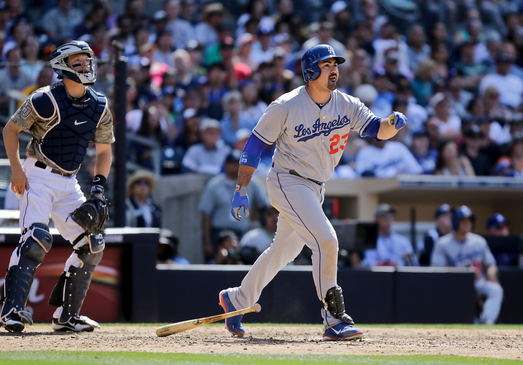 . Los Angeles Dodgers\' Adrian Gonzalez admires his ninth inning home run against the San Diego Padres in a baseball game in San Diego, Sunday, June 23, 2013. (AP Photo/Lenny Ignelzi)
