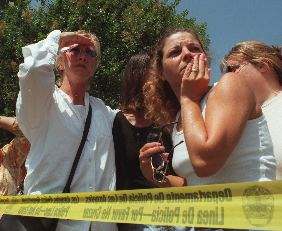 . Parents and onlookers wait for news about children inside the daycare center of the North Valley Jewish Community Center.  Five victims, three male children and two female adults, were shot in the lobby of the North Valley Jewish Community Center in Granada Hills, California Tuesday morning, August 10, 1999.   Los Angeles Daily News file photo.